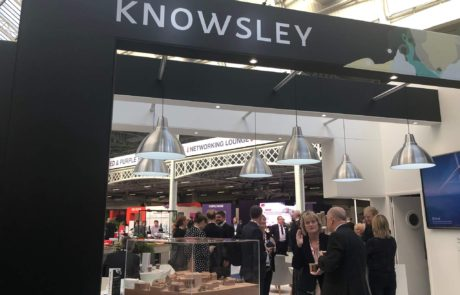 People talking at the Knowsley MIPM stand.